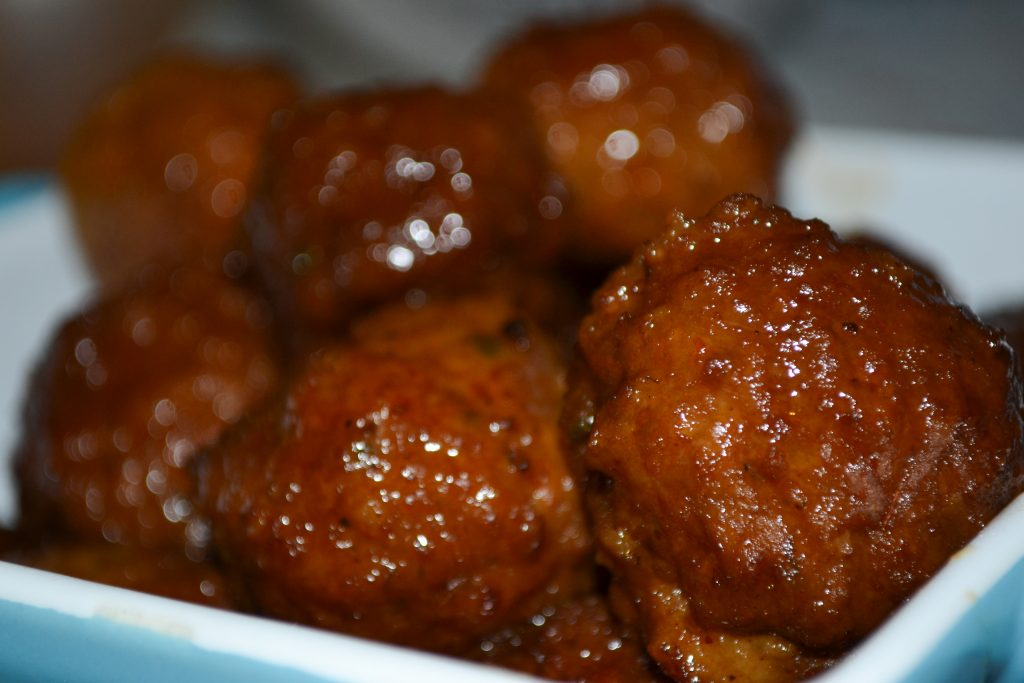 Crowd pleaser slow cooker meatballs that are sweet, tangy and juicy!